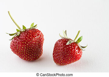 Fresh Picked Ripe Strawberries - Close up of two fresh...