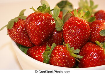 Fresh picked strawberries in a white bowl....