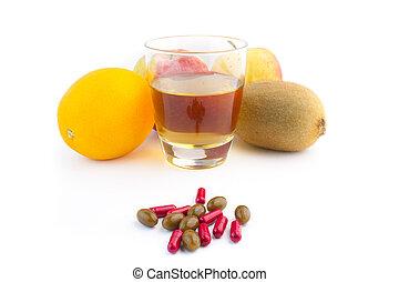 fresh pills for a diet - Pills with fresh fruit on white...