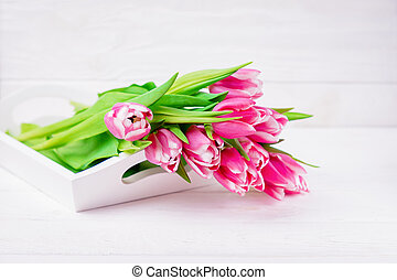 Fresh pink magenta tulips flowers on a white background. Top view