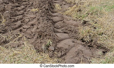 fresh plowed field stork - wheel marks on freshly plowed...