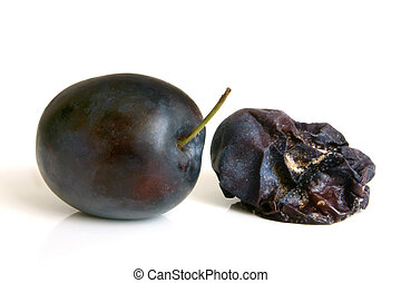 Fresh plum and rotten plum on the white background