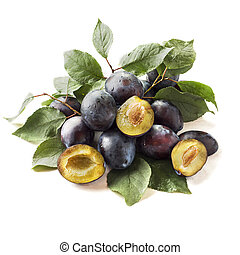 Fresh plum fruit with leaves isolated on white background