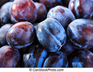 fresh plums as background