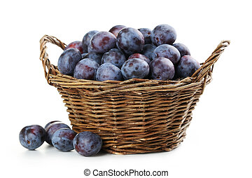 Fresh plums in basket isolated on a white