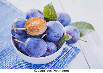 plums on the white wooden table