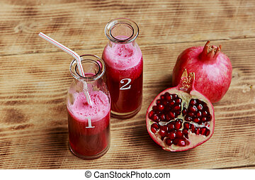 Fresh pomegranate juice in a bottle
