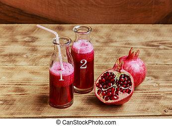 Fresh pomegranate juice in a bottle
