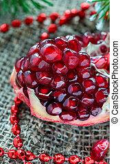 Fresh pomegranate with festive decorations