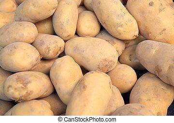 fresh potato selling on vegetable market