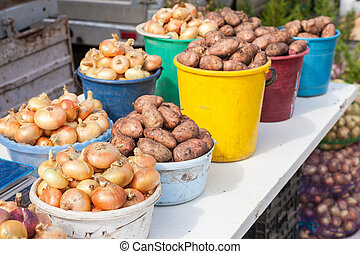Fresh potatoes and onion of new harvest ready to sale at the local farmers market