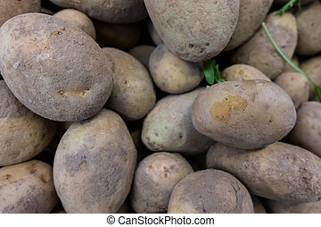 Fresh potatoes in a market stall.