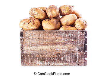 fresh potatoes in wooden box on white background