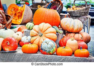 Fresh pumpkins at country market