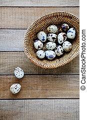 Fresh quail eggs in a basket
