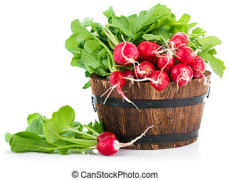 Fresh radish with green leaves in wooden bucket