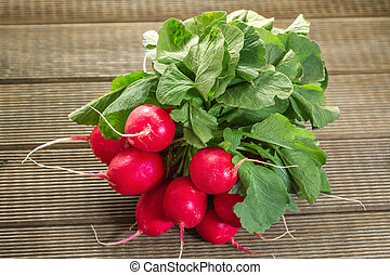 Fresh radishes on a wooden table