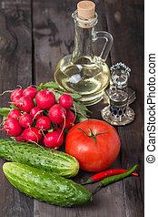 Fresh radishes, tomatoes, cucumbers and olive oil