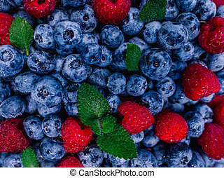 Fresh raspberries and blueberries great bilberry background...