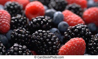 Fresh raspberries, blackberries and blueberries, seamless...