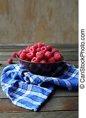 fresh raspberries in a bowl on the table