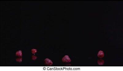 Fresh raspberries isolated on black background HD