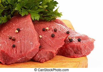 beef meat - fresh raw beef meat slices over a wooden board