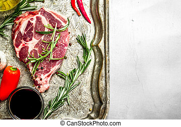 Fresh raw beef meat with spices and herbs.