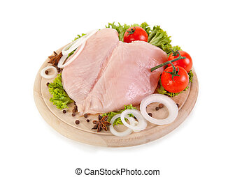 Fresh raw chicken breasts with vegetables