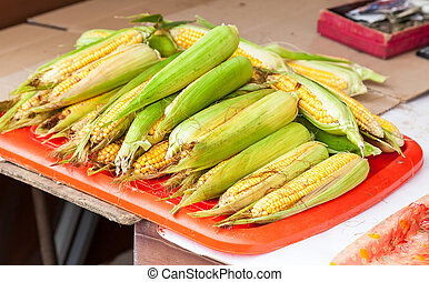 Fresh raw corn ready to sale at the farmers market