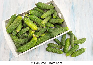 Fresh raw cucumbers in a box