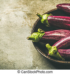 Fresh raw Fall harvest purple eggplants, copy space - Fresh...