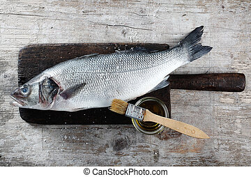 Fresh Raw Fish on Wood Board with Oil and Brush