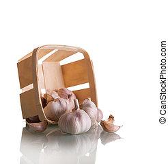 Fresh raw garlic in wicker basket isolated on white background