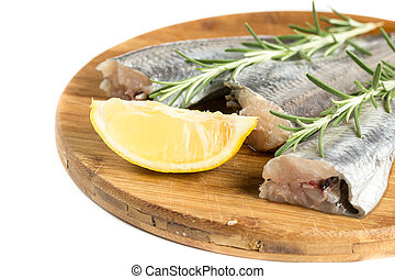 Fresh raw hake with lemon and rosemary branches