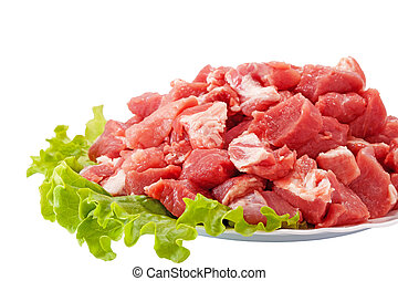 Fresh raw meat and salad isolated on white