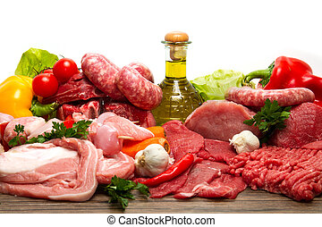 Fresh Raw Meat - Fresh butcher cut meat assortment garnished...
