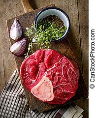 fresh raw meat on wooden cutting board