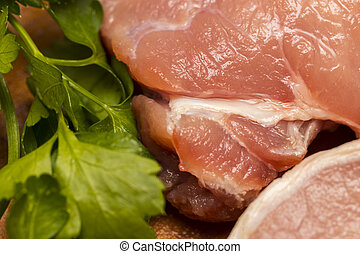 Fresh raw meat with spices on wooden background
