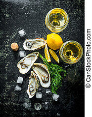 Fresh raw oysters with ice cubes, dill, lemon and wine.