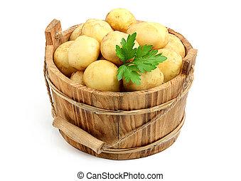 Fresh, raw potatoes in a bucket.