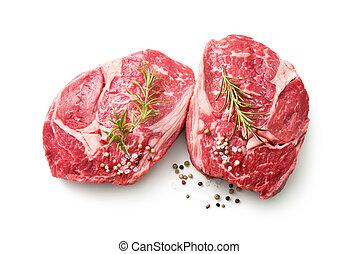 fresh raw rib eye steaks isolated on white background