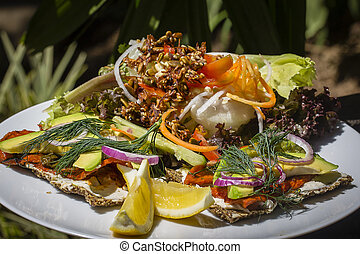 Fresh raw salad from lettuce, avokado, tomato, papaya smoked...