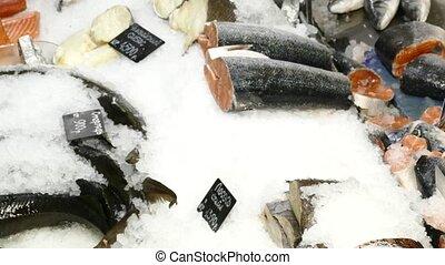 Fresh raw salmon on counter at food market.