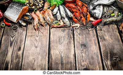 variety of seafood on a fishing net.
