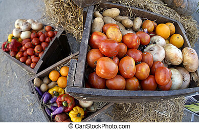 Fresh Raw Tomatoes, Orange, Potatoes, eggplant, onion, and sweet pepper in Wooden Box