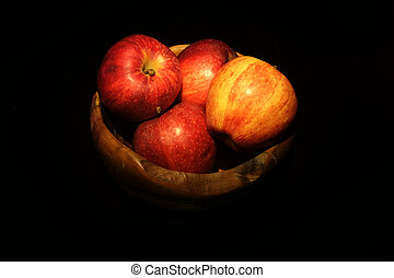 Fresh red Apple in a wooden bowl