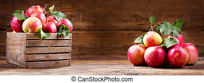 fresh red apples in a wooden box