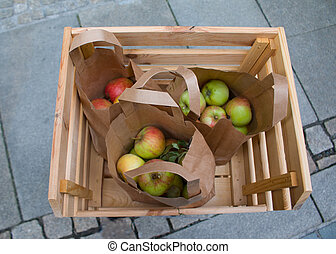 Fresh red apples in a wooden .