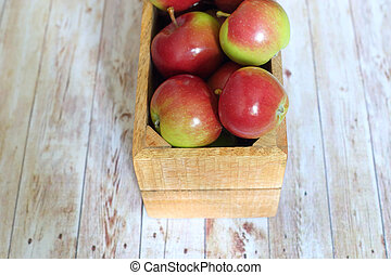 fresh red apples in wooden box